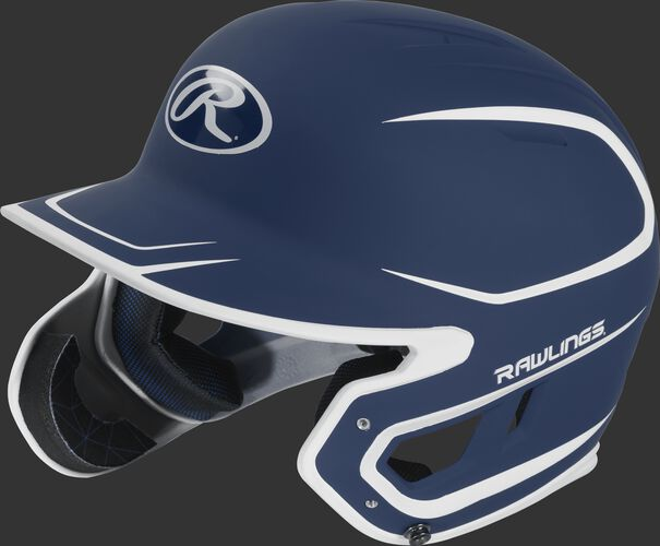 Left angle view of a MACHEXTR Rawlings Mach EXT Junior helmet with a two-tone matte navy/white shell