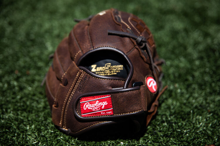 Rawlings patch on a Player Preferred recreational glove on a field - SKU: P120BFL