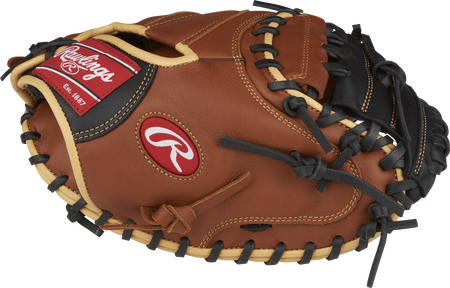 Thumb view of a brown SCM33S 33-inch catcher's mitt with a black One-Piece Solid web
