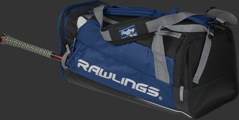 Side angle view of a navy R601 Hybrid players duffel bag with a bat in the side sleeve