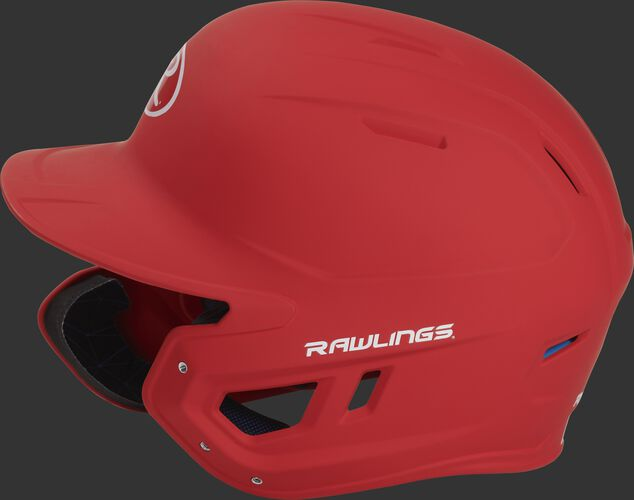 Left side of a MACHEXTL senior Rawlings batting helmet with a one-tone matte scarlet shell