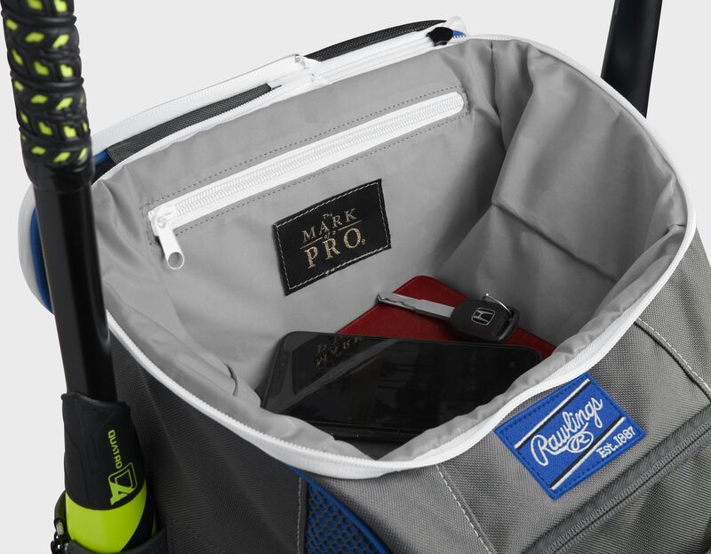 """Top compartment of a royal Impulse bag with a phone, keys and black """"The Mark of a Pro"""" patch - SKU: IMPSLE-R"""