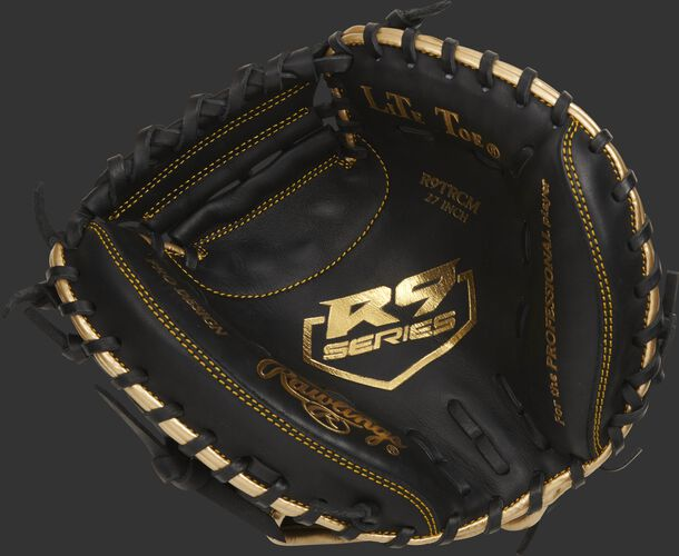 Palm of a black Rawlings R9 series catcher's training mitt with a gold palm stamp and black laces - SKU: R9TRCM