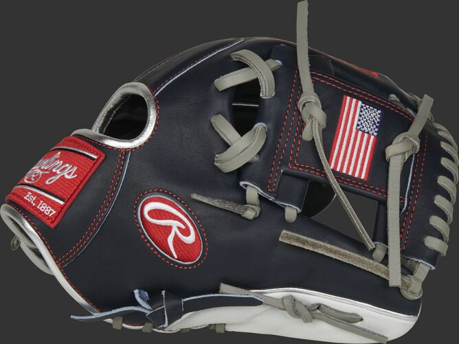 Thumb of a navy PRO204-2USA Heart of the Hide USA infield glove with a USA flag on the navy I-web
