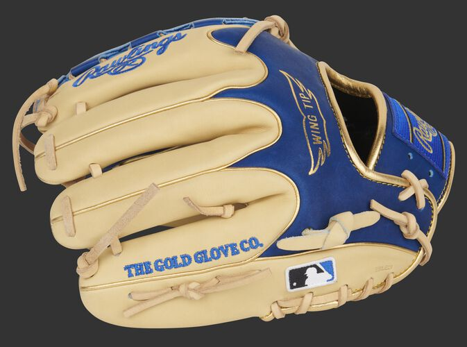 Camel finger backs of a Heart of the Hide Wing Tip infield/pitcher's glove with the MLB logo on the pinkie - SKU: PRO205W-12CR