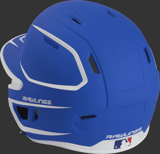 Back left view of a matte royal/white MACH series batting helmet with air vents