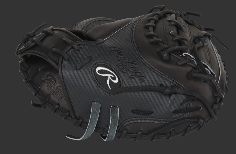 Black thumb of an exclusive Pro Preferred 34-Inch Hyper Shell catcher's mitt with a black 1-piece solid web - SKU: PROSCM41B