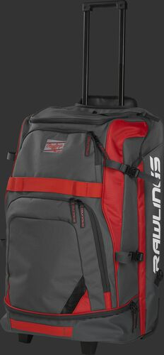 Left angle view of a grey/scarlet R1801 catcher's backpack with the pull handle extended