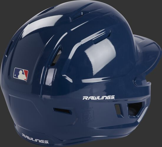 Back right of a MCH01A Rawlings Mach baseball batting helmet with a navy shell
