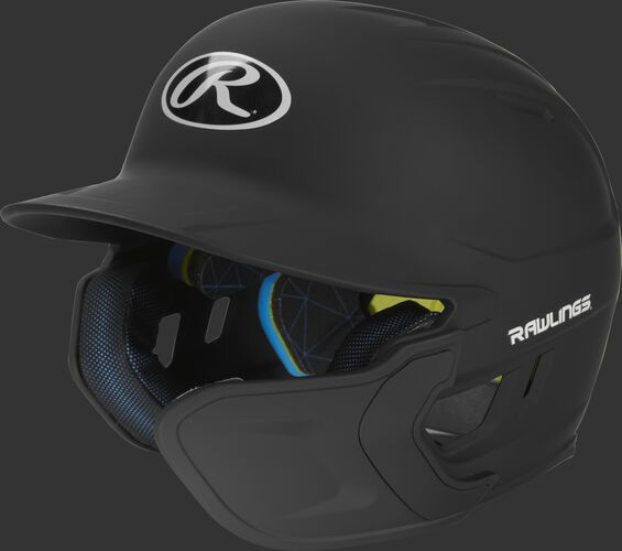 Left angle view of a matte black MACHEXTR Mach Junior helmet with Mach EXT right hand batter face guard extension