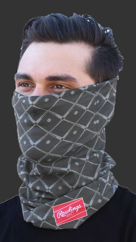 A guy wearing a graphite Rawlings adult multi-functional head and face cover around his mouth and nose - SKU: RC40005-005