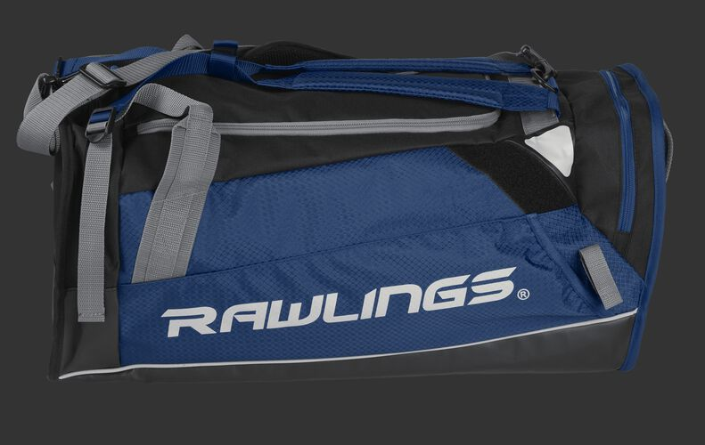 Side of a navy R601 Hybrid backpack/duffel players bag with black trim and a white Rawlings logo on the bat sleeve