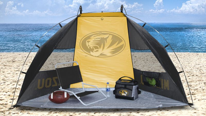 A Mizzou Tigers sun shelter set up on a beach with a cooler, chair, football and water bottle - SKU: 00973086111