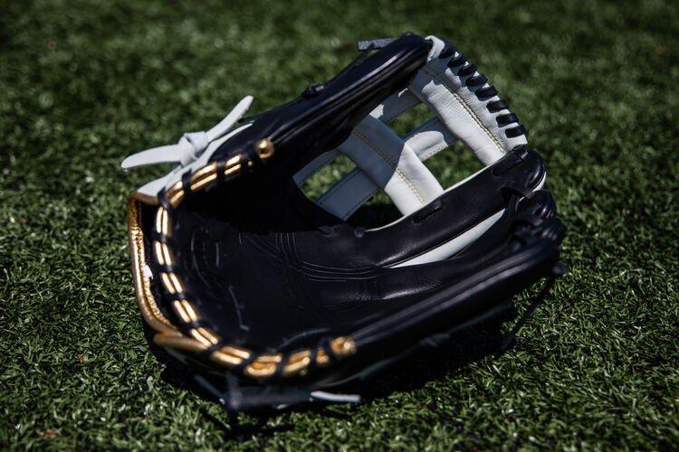 Black palm of a 12.25-Inch Encore H-web glove lying on a field - SKU: EC1225-6BW