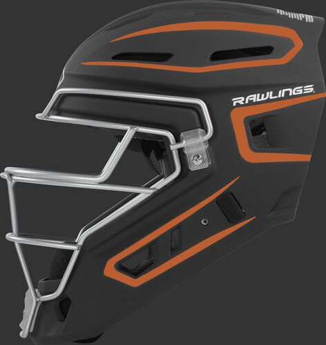 Left side of a black/orange CHV27J Rawlings hockey style Velo 2.0 catcher's helmet