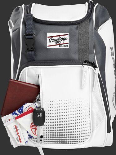 Wallet, keys and batting gloves in the front valuables pocket of a white Franchise baseball bag - SKU: FRANBP-W