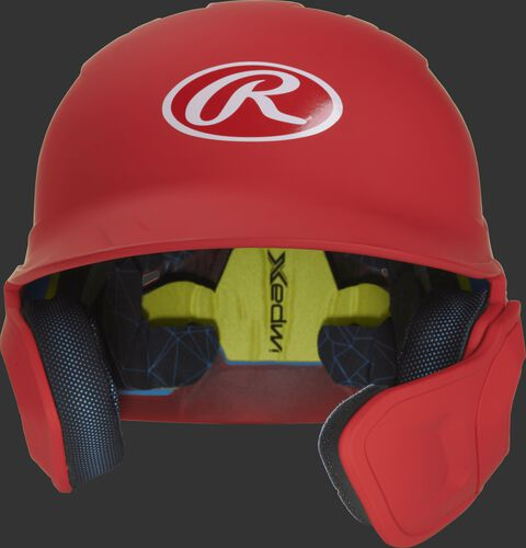 Front of a matte scarlet MACHEXTR high school/college Mach batting helmet with face guard extension for right hand batters