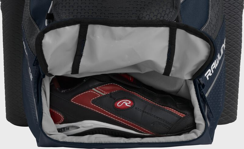 A navy Rawlings baseball backpack with a cleat in the bottom cleat storage compartment - SKU: IMPLSE-N