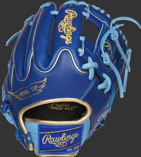 Wing Tip back of a royal Heart of the Hide I-web glove with a royal Rawlings patch - SKU: PRO204W-2R