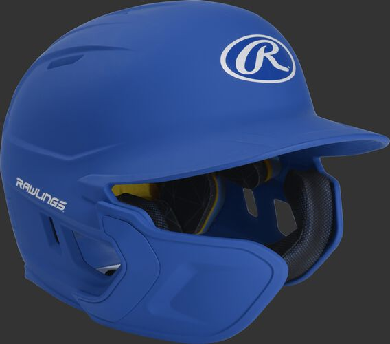 Right angle view of a matte royal MACHEXTL Mach Junior helmet with Mach EXT left hand batter face guard extension