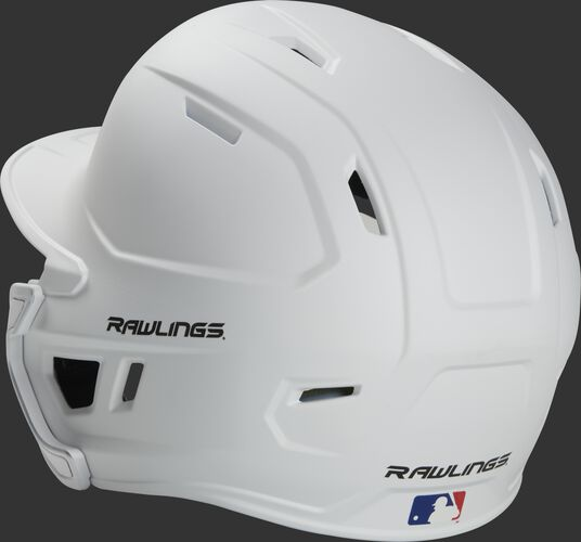 Back left view of a matte white MACHEXTR MACH series batting helmet with air vents