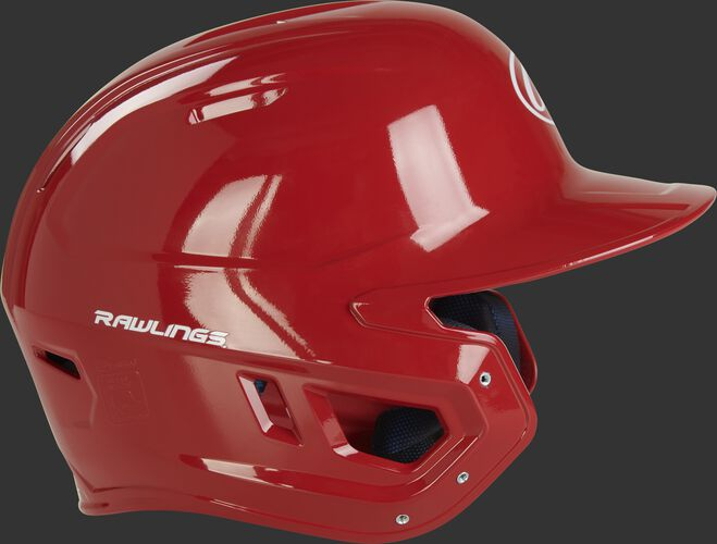 Right side of a MCH01A Rawlings Mach helmet with a scarlet shell and compatible with a MEXT face guard extension