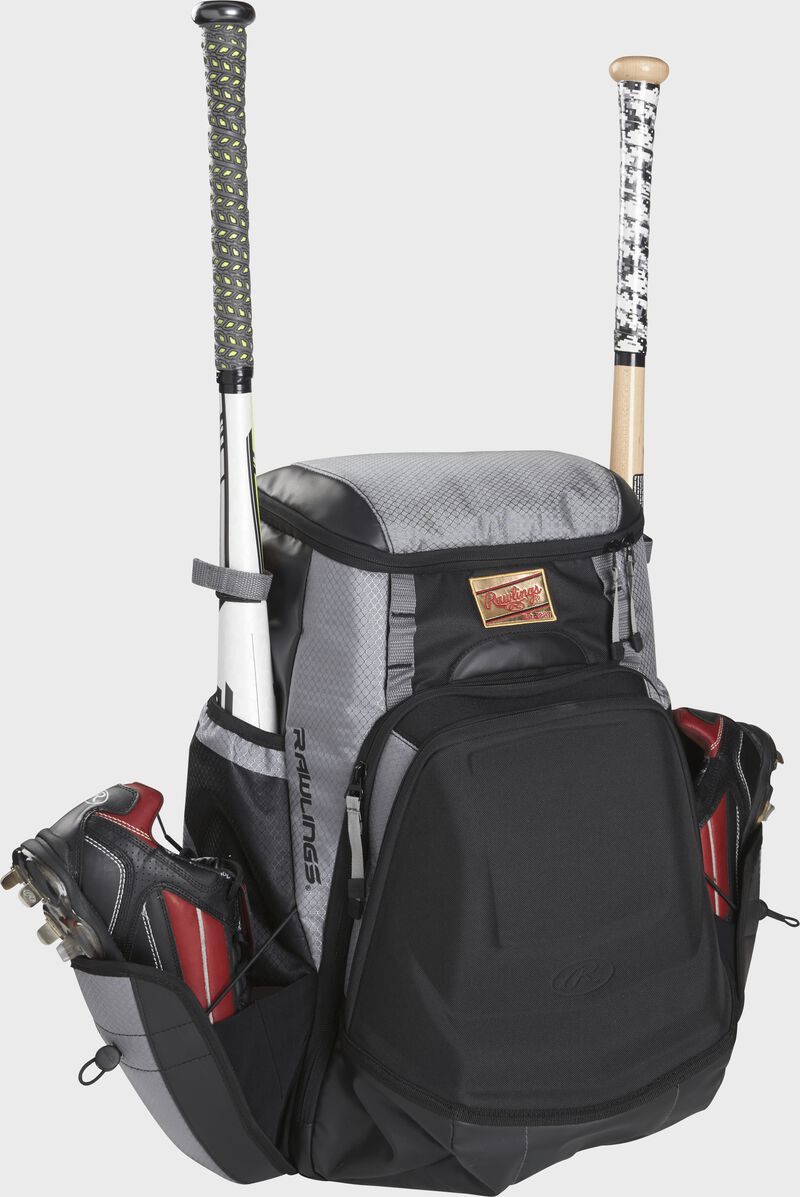 Front right of a black/gray R1000 Gold Glove Series baseball backpack with two bats and cleats
