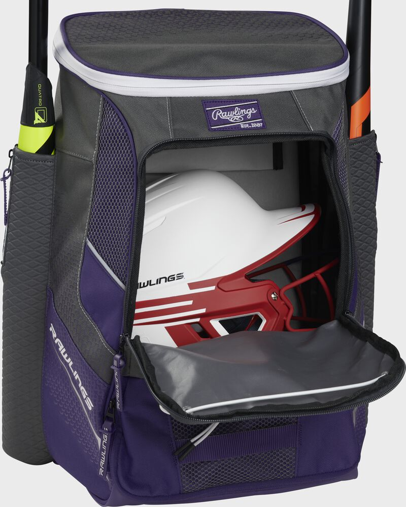A purple Impulse baseball backpack with a helmet in the main compartment - SKU: IMPLSE-PU