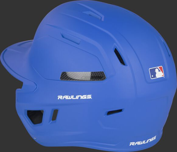 Back left of a matte royal CAR07A MACH Carbon baseball helmet with air vents in the back