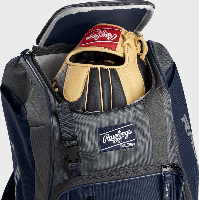 A Rawlings baseball glove in the top compartment of a Franchise baseball backpack - SKU: FRANBP-N