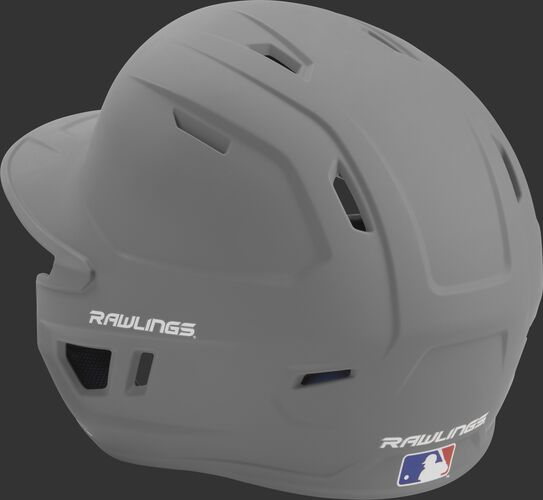 Back left view of a matte silver MACH series batting helmet with air vents