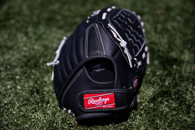 Rawlings patch on the wrist band of a RSB softball glove lying on a field - SKU: RSB140GB