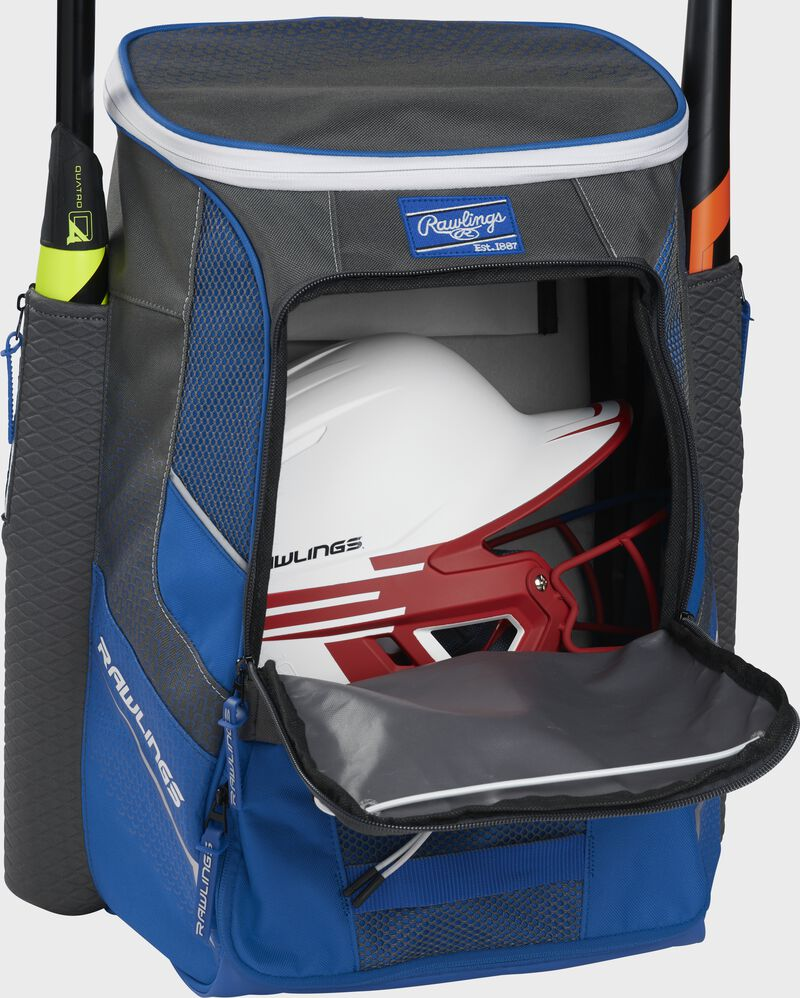 A royal Impulse baseball backpack with a helmet in the main compartment - SKU: IMPLSE-R