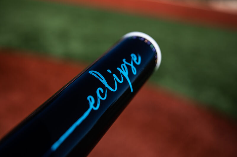 Black barrel of a 2020 Eclipse fastpitch bat with a field in the background - SKU: FPZE12