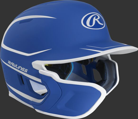 Right angle view of a matte royal/white MACHEXTR Mach Senior helmet with Mach EXT left hand batter face guard extension