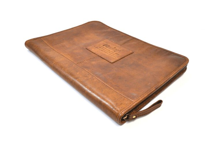 Angled view of a tan rugged portfolio with the zipper on the bottom - SKU: V614-202