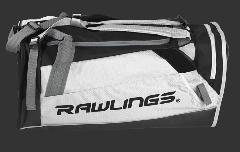 Side of a white R601 Hybrid backpack/duffel players bag with black trim and a black Rawlings logo on the bat sleeve