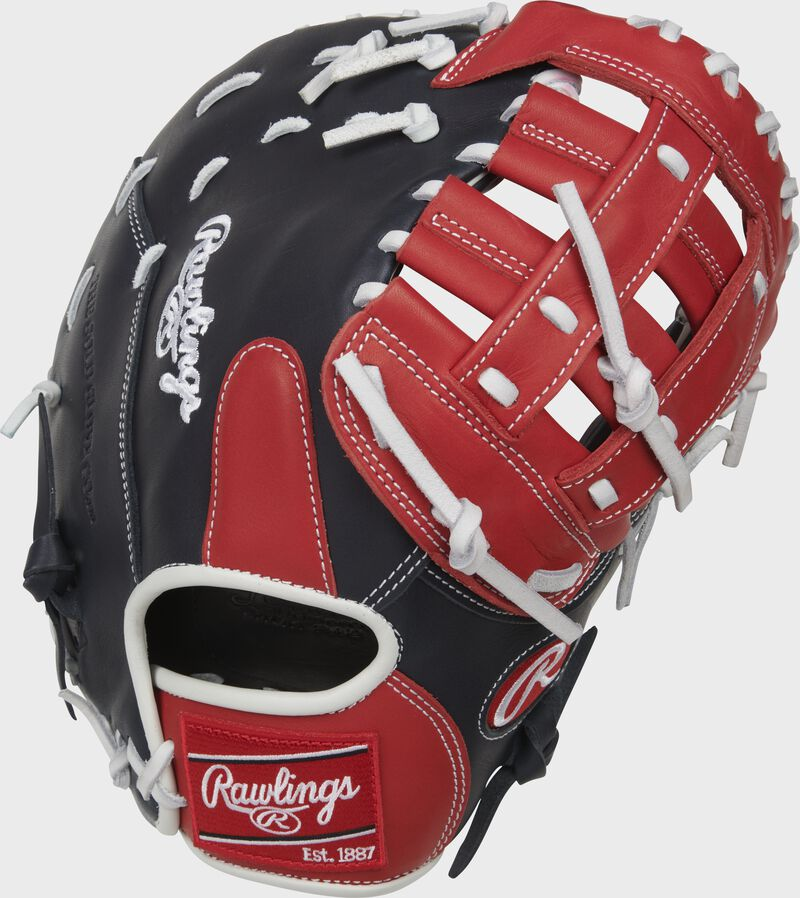 Navy back of a Breakout 12-Inch youth 1st base mitt with a red Rawlings patch - SKU: RSGBOYPTFM16NS