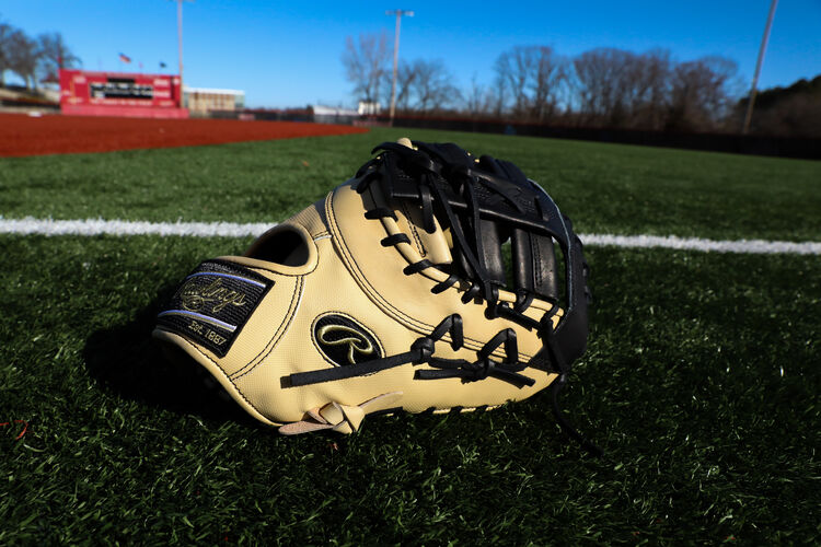 Thumb view of a camel Rawlings Heart of the Hide ColorSync 5.0 1st base mitt on a field - SKU: PRODCTCBGSS