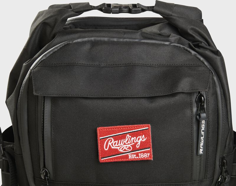 Top front of a black CEO backpack with a Red Rawlings patch and the clips on top - SKU: CEOBP-B