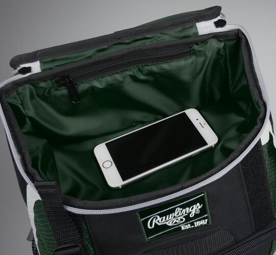 Top accessory pocket of a black/dark green R500 equipment backpack holding a phone