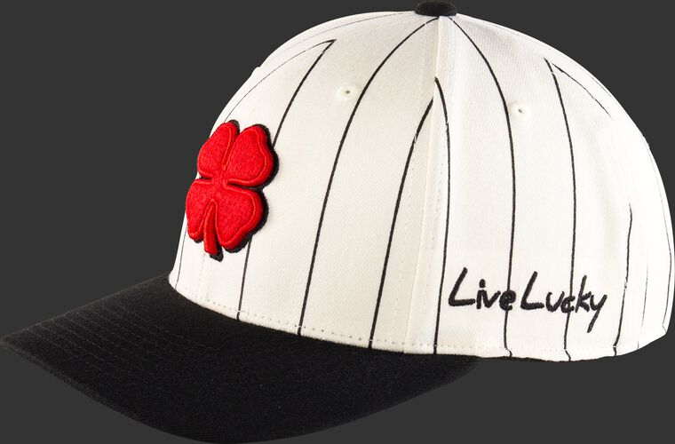 "Side of a white Rawlings Black Clover Retro hat with ""Live Lucky"" on the side and black pinstripes - SKU: BC0R00071"