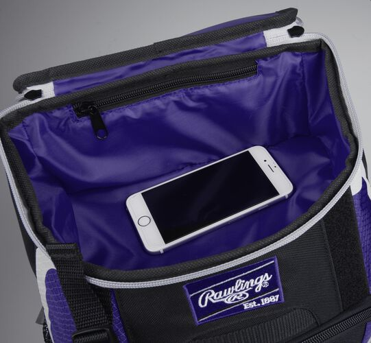 Top accessory pocket of a black/purple R500 equipment backpack holding a phone