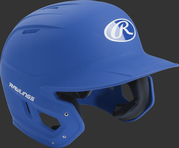 Right angle view of a matte MACH Senior batting helmet with a royal shell
