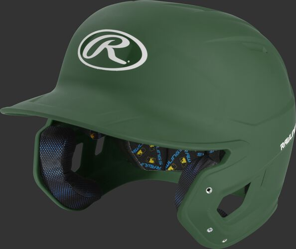 Left angle view of a dark green MCH07A Mach high school/college batting helmet