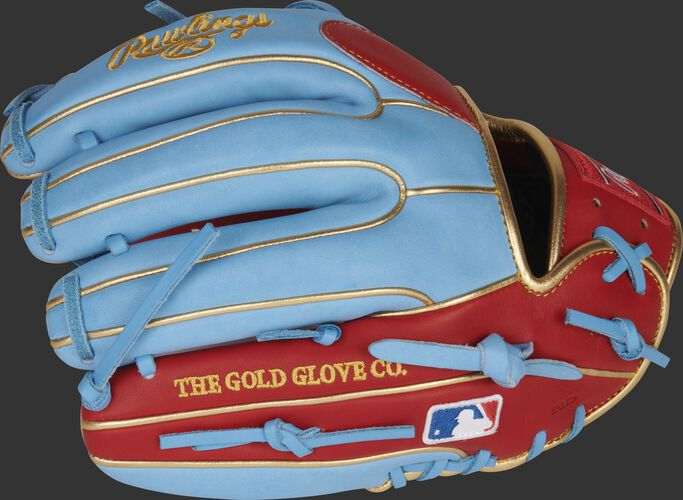 Back of a columbia blue/scarlet Kolten Wong Heart of the Hide glove with the MLB logo on the pinky - SKU: RSGPRO314-7SCB