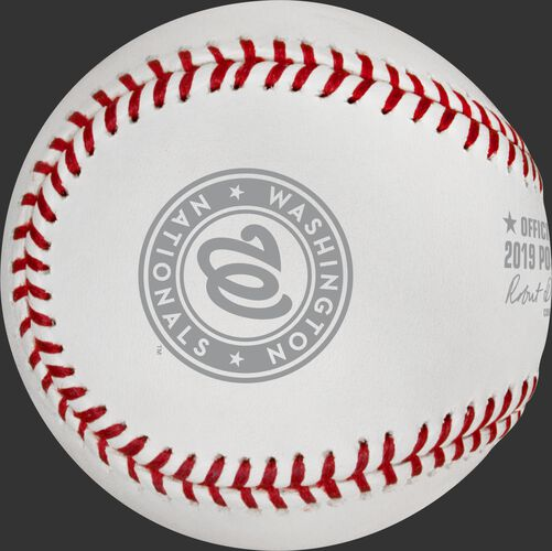 A grey Washington Nationals logo stamped on a NLCS19CHMP Washington Nats' NLCS Champions baseball