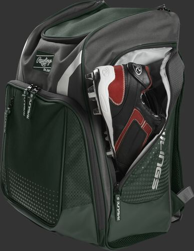 A cleat in the side cleat pocket of a dark green Legion baseball backpack - SKU: LEGION-DG