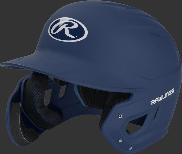 Left angle view of a MACHEXTL Rawlings Mach EXT Senior helmet with a one-tone matte navy shell
