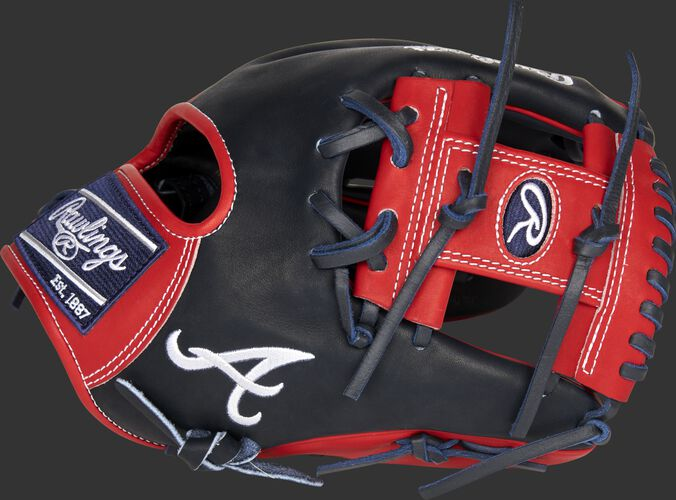 Thumb of a navy 2021 Atlanta Braves Heart of the Hide glove with the Braves logo on the thumb - SKU: RSGPRO204-2ATL
